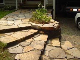 With the driveway lower than the front door, this retaining wall and flagstone front walkway were a nice addition.