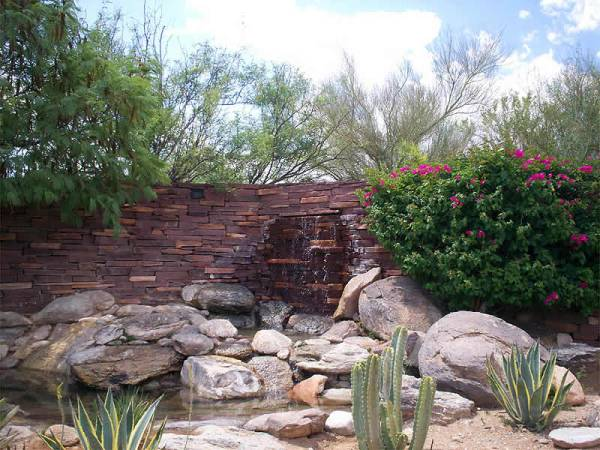 Water feature ideas for the creative minded. The water source comes from the flagstone wall instead of a built up feature in the corner.