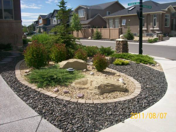 Driveway landscaping for a corner lot done with xeriscaping.