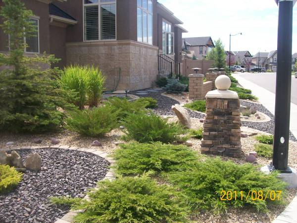 Xeriscaping a front yard with two contrasting decorative rocks. The ...