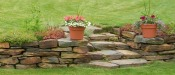 small natural stone retaining wall and staircase.