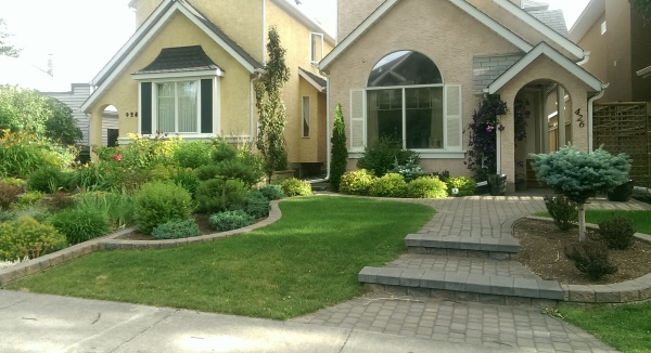 Landscaping between houses is the best example you will find of landscaping themes that visually fight each other because they lack a barrier or separation. Do these 2 designs work?