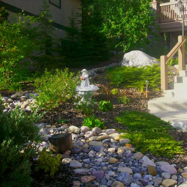 This Design Shows How A Steeply Sloping Front Yard Can Be Tamed Without Using Retaining Walls