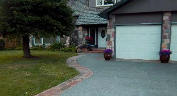 This strip of flagstone driveway eding is an attractive and practical way to provide curb appeal.