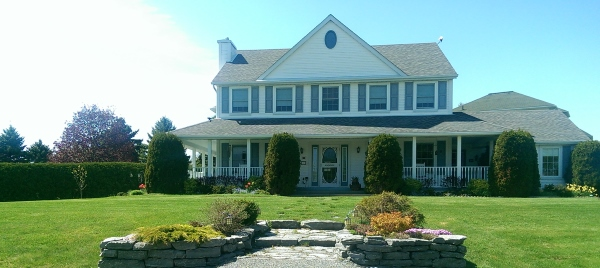 A nice flagstone front entry was added to this property to break up the large front lawn and add some curb appeal.