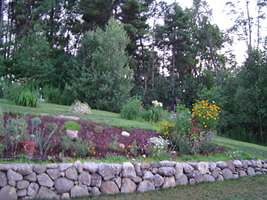 This natural stone wall creates a more gentle slope.