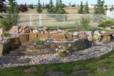 How to build a backyard waterfall tips for Build a simple backyard waterfall