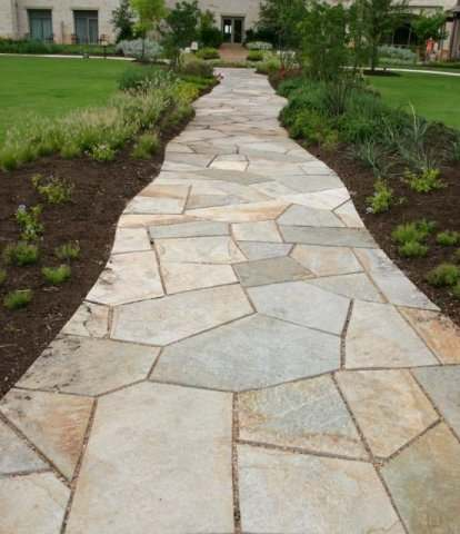 Cut flagstone walkway with small gaps (about 1 inch).