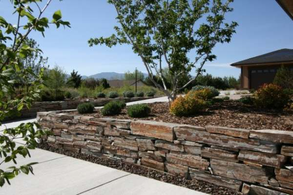 Wallstone is used here to line the driveway and support raised beds on both sides.