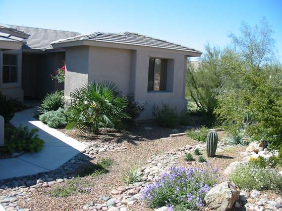 Another front yard design with some more lush, mixed plantings leading up to a courtyard style entrance.
