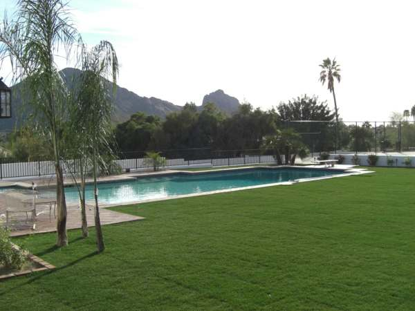 A very simple and clean design for a desert region backyard with a pool.