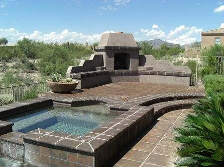 A nice untamed view of a wide open desert directly behind this backyard.