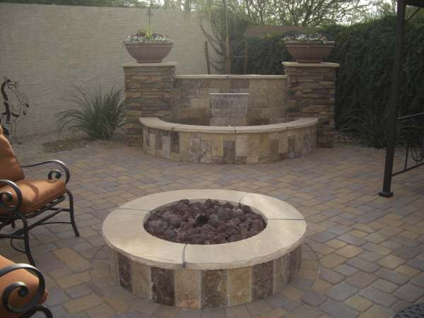 A formal firepit area in a private corner, makes a nice place to retreat for an evening.