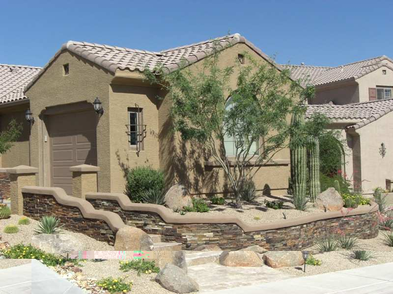 These front steps lead to a beautiful gated entryway for a desert courtyard.