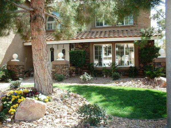 What may have been a plain, flat yard has been transformed with rock, shrubs and just the right amount of lawn.