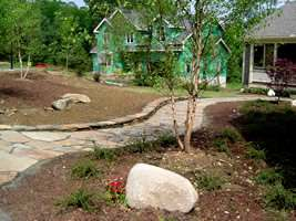 This flagstone walkways looks right at home in this country landscape.