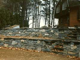 This multi level flagstone wall with fieldstone mixed in at various spots, has tons of character.