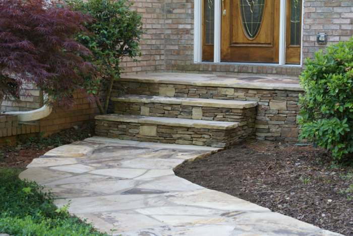 Flagstone walkway leading up to front door steps.