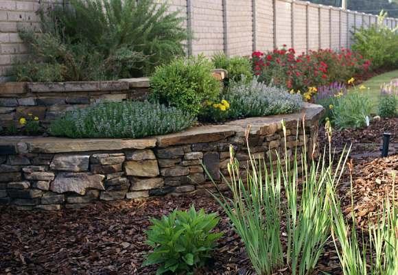 Perennial garden makes a nice border following the perimeter fencing.