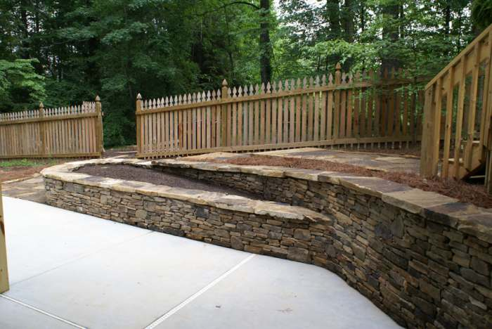 Retaining walls are great ways to make more usable space in a yard.