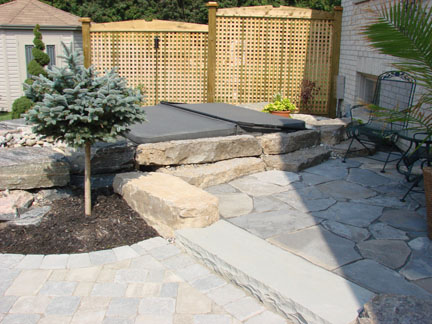 A nice, private, and partially shady corner make a great location for a patio and hot tub.