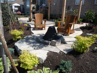 This brick patio extends out to a cozy little firepit area.