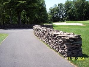 Dry stacked stone walls finish off just about any landscape.