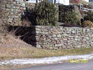 Selecting and placing just the right stones for building corners can be a very timely process.
