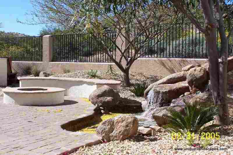 A Nice Brick Patio Area With A Firepit And Seating Surrounded By Natural  Desert Plants.