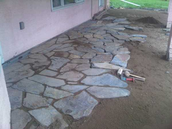 Packing In Stones For A Patio Working Away From A Lower Entrance. The  Highest Point For Drainage Will Be Along The House Line, And The Lower  Entrance Which ...