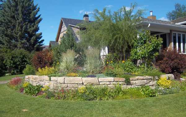 Corner lot landscaping ideas like this small curved stone are a great way to add curb appeal.