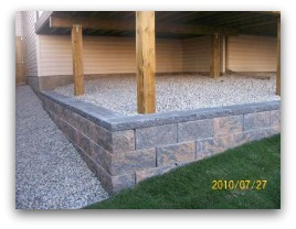 Manufactured block retaining wall.