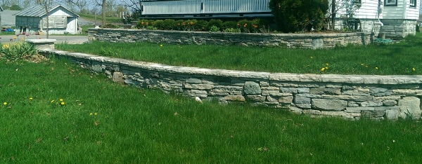 A local landscaper I met built this wall for his own house using left over mixed pieces from many different projects. Mixed walls seem to have the most character.
