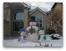 Inflatable snowmen are a very popular item in recent years. Snowman picture of Frosty and his kids.