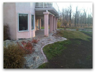 This picture shows the new sod, old lawn, and the soil over top of the old lawn. Blending lawn requires patience.