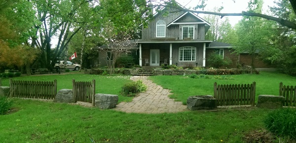 This is a unique ideas for a front yard with large rocks between smaller sections of fencing.