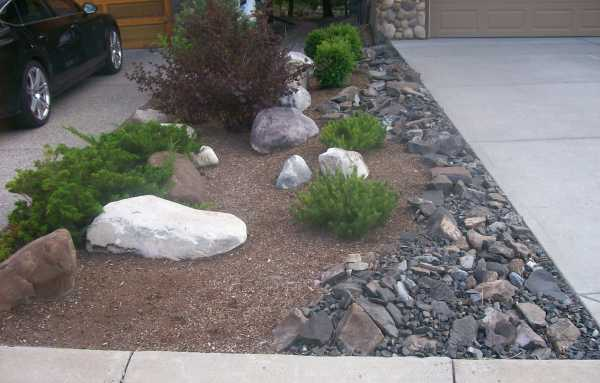 Driveway landscaping photo for Garage door repair round lake il