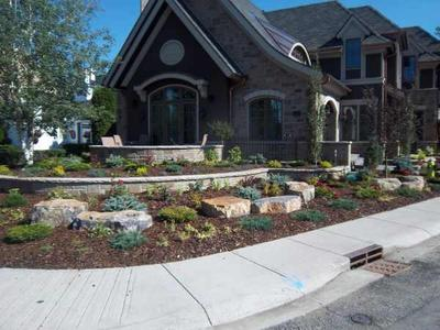 Making use of a corner lot with a house set back from the corner. Note how the stone wall flows with the sidewalk corner.