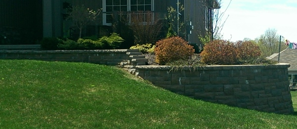 This front yard retaining wall extended the front entryway into a nice garden bed while avoiding a steep slope to mow.