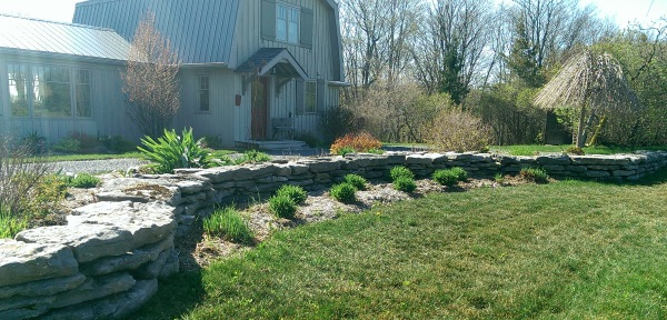 This front yard added a dry stacked low fieldstone decorative wall that fits right in the country setting it's in.