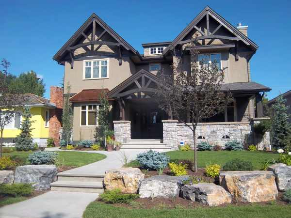The large rocks and tree used here add needed height to this front yard landscaping design.