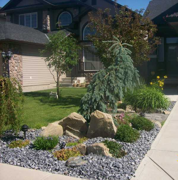 Attractive driveway landscaping for a small front yard.