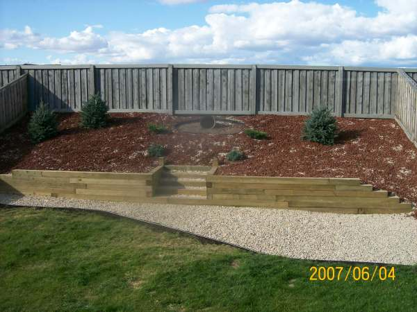 This slope was covered with landscape fabric and planted with some drought tolerant shrubs before being topped with decorative rock.