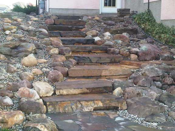 This newly completed project is waiting for shrubs to add some colour. These natural stone slab steps and rock garden, replaced a steep, slippery, and often muddy hill.