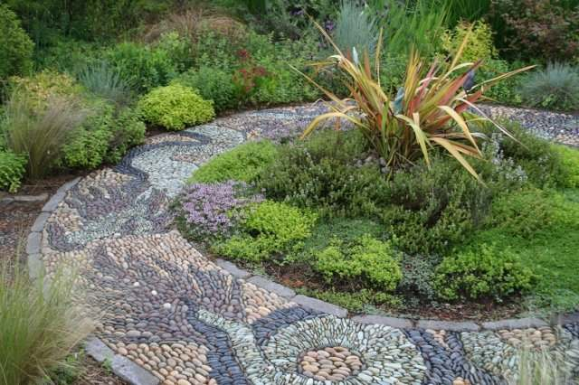 This very creative and beautiful walkway of different coloured stones is considered a mosaic.