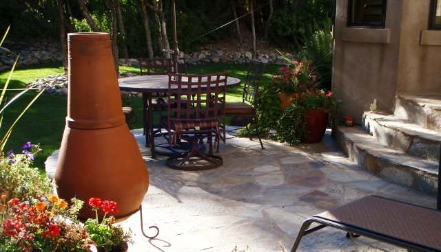 Natural flagstone patio makes a nice quaint place for an outdoor meal.