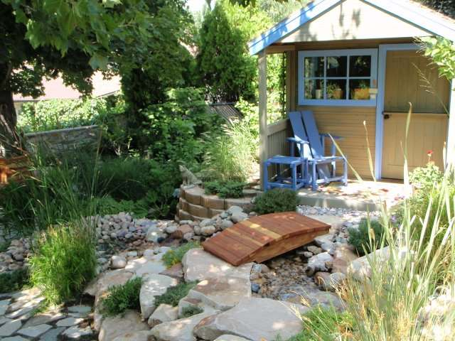ornamental grasses and a few shrubs give life to the stones used in