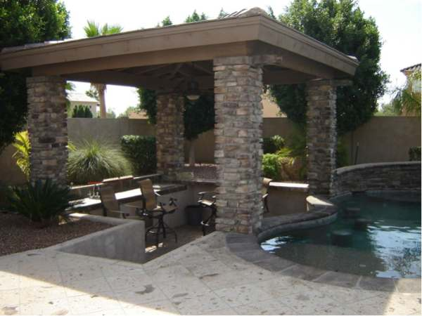 Poolside swim up seating for a sunken patio area with bar is sheltered from the hot sun.