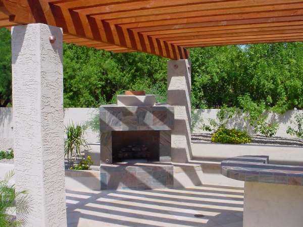 Outdoor fireplaces are becoming more and more popular, like this one situated just off this outdoor kitchen area.
