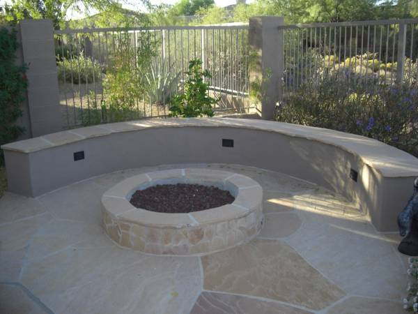 A formal mortared flagstone firepit area.